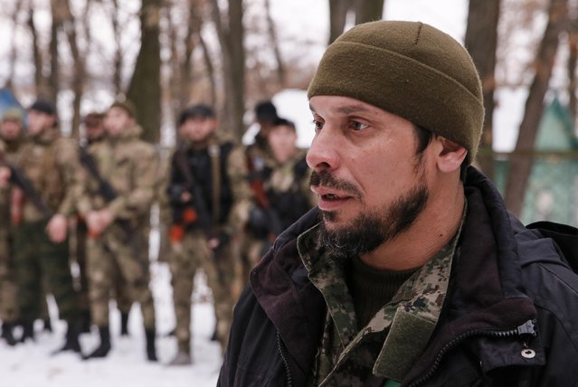 """One of the pro-Russian separatist leaders from the Chechen """"Death"""" battalion, identified as his nickname """"Stinger"""", speaks during a training exercise in the territory controlled by the self-proclaimed Donetsk People's Republic, eastern Ukraine, December 8, 2014. (Photo by Maxim Shemetov/Reuters)"""