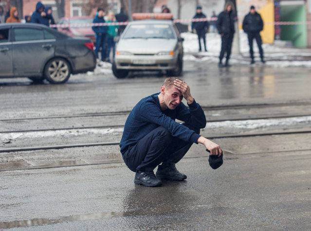 A man reacts at the scene of a fire in a shopping mall in the Siberian city of Kemerovo, Russia March 25, 2018. (Photo by Marina Lisova/Reuters)