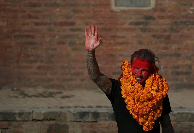 David Beckham waves towards his fans while on his way back after playing a charity soccer match to collect funds for the United Nations Children's Fund (UNICEF) at the ancient city of Bhaktapur, Nepal November 6, 2015. (Photo by Navesh Chitrakar/Reuters)