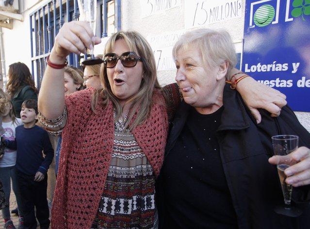 "Winners of Spain's Christmas Lottery ""El Gordo"", in La Eliana near Valencia December 22, 2014. (Photo by Heino Kalis/Reuters)"