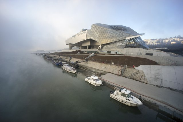 An exterior view of the Confluences Musee is seen on the southern tip of the peninsula where the Rhone and Saone rivers join in Lyon, France December 23, 2014. The museum, which opened December 20, includes collections of natural science, anthropology and Earth Sciences from the Guimet Natural History Museum. Austrian architects Coop Himmelb(l)au designed the museum. (Photo by Robert Pratta/Reuters)