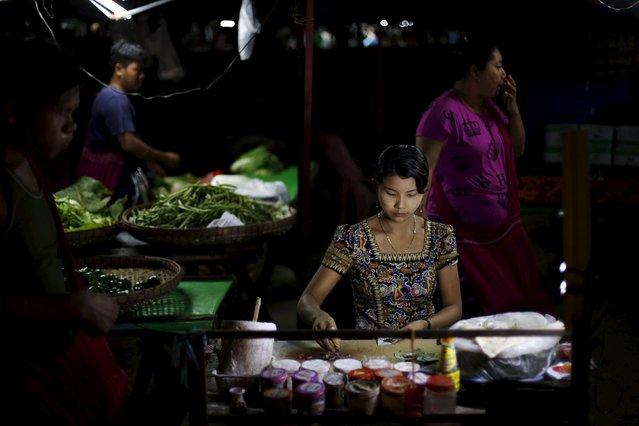 A woman sells betel at the Thiri Mingalar market in Yangon November 6, 2015. (Photo by Jorge Silva/Reuters)