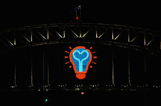 A light bulb motif made from LED lights is pictured on the side of the  Sydney Harbour Bridge following the annual fireworks display to usher in the new year, early January 1, 2015. More than 10,000 aerial fireworks, 25,000 shooting comets and 100,000 pyrotechnic effects were used during the annual Sydney Harbour New Year's Eve show. (Photo by Jason Reed/Reuters)