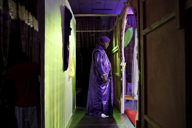 The master of ceremonies stands backstage at the Festi'Bazin runway show in Bamako, Mali, October 16, 2015. (Photo by Joe Penney/Reuters)