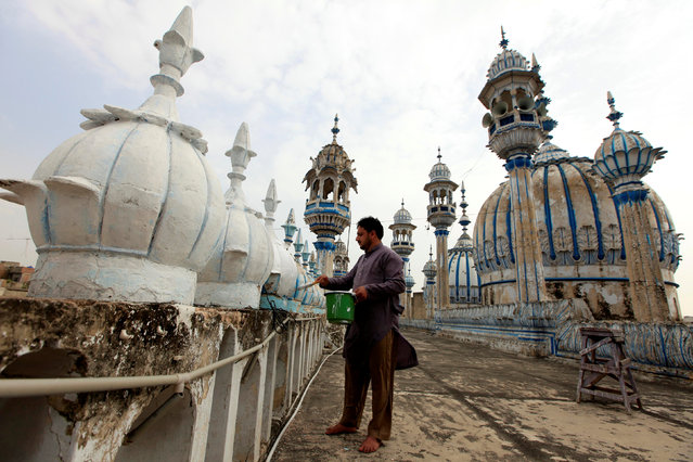 A man carries out cleaning work at Jamia Masjid (Grand Mosque) ahead of Muslim holy month of Ramadan in Rawalpindi, Pakistan May 15, 2018. (Photo by Faisal Mahmood/Reuters)