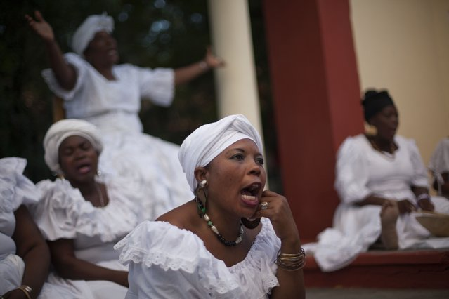 A woman sings during a voodoo ceremony marking the fifth anniversary of the earthquake at the National Ethnology Bureau in Port-au-Prince, Haiti, Monday, January 12, 2015. The ceremony was held at the exact time the quake struck in 2010, at 4:53 p.m. (Photo by Dieu Nalio Chery/AP Photo)