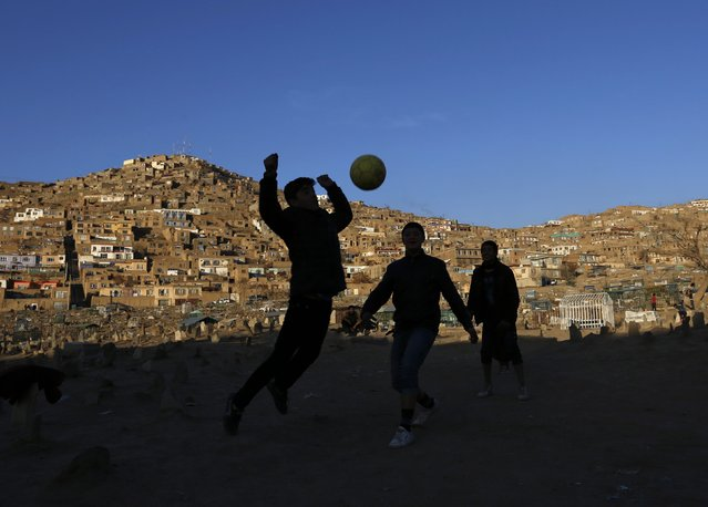 Afghan boys play soccer in Kabul January 14, 2015. (Photo by Mohammad Ismail/Reuters)