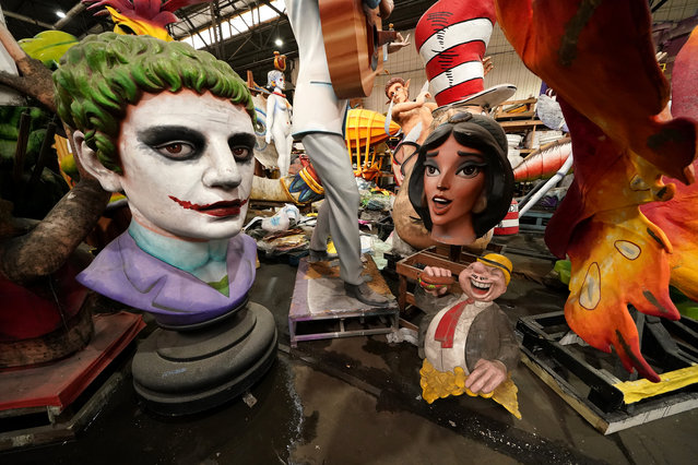 Parts of Mardi Gras floats created by Kern Studios sit stored inside Mardi Gras World in New Orleans, Friday, February 12, 2021. New Orleans' annual pre-Lenten Mardi Gras celebration is muted this year because of the coronavirus pandemic. Parades canceled. Bars closed. Crowds suppressed. Mardi Gras joy is muted this year in New Orleans as authorities seek to stifle the coronavirus's spread. And it's a blow to the tradition-bound city's party-loving soul. (Photo by Gerald Herbert/AP Photo)