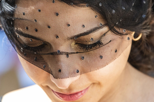 A woman wearing beaded netting is seen during Golden Eagle Day at Rosehill Gardens on October 31, 2020 in Sydney, Australia. The Golden Eagle is the third richest race in Australia and is run on the final day of the Australian Turf Club Everest Carnival. (Photo by Jenny Evans/Getty Images)