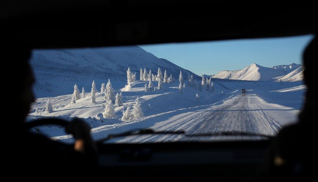 """The """"Road of Bones"""" leading to the village of Oymyakon, Russia, January 2013. (Photo by Amos Chapple/REX Features)"""