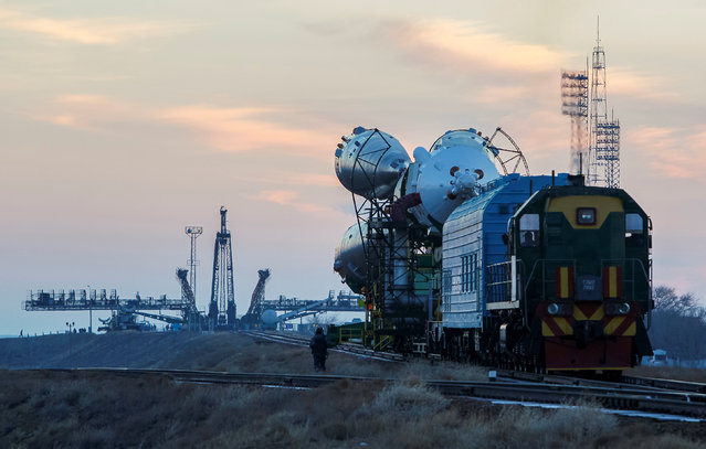 The Soyuz MS-03 spacecraft for the next International Space Station (ISS) crew of Peggy Whitson of the U.S., Oleg Novitskiy of Russia and Thomas Pesquet of France, is transported from an assembling hangar to the launchpad ahead of its upcoming launch, at the Baikonur cosmodrome in Kazakhstan, November 14, 2016. (Photo by Shamil Zhumatov/Reuters)
