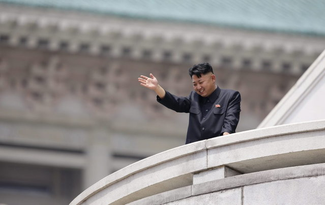 North Korean leader Kim Jong-un waves to the people during a parade to commemorate the 60th anniversary of the signing of a truce in the 1950-1953 Korean War, at Kim Il-sung Square in Pyongyang July 27, 2013. (Photo by Jason Lee/Reuters)