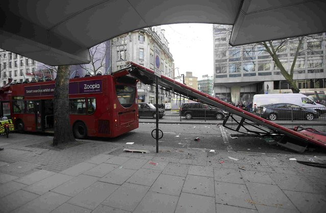 A bus sits with its roof ripped off on the Kingsway in central London February 2, 2015. (Photo by Peter Nicholls/Reuters)