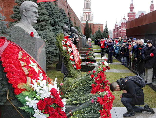 Russian communists lay flowers at Soviet leader Joseph Stalin's tomb on Red Square next to the Kremlin wall in Moscow, Russia, December 21, 2015. Russian communists are marking the 136th anniversary of Josef Stalin's birthday. (Photo by Sergei Ilnitsky/EPA)