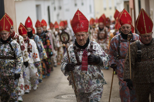 "Aniceto Rodrigo, 78, Diablo Mayor or ""greater devil"", center, leads the ""Endiablada"" traditional festival  in Almonacid Del Marquesado, Spain, Tuesday, February 3, 2015. (Photo by Daniel Ochoa de Olza/AP Photo)"