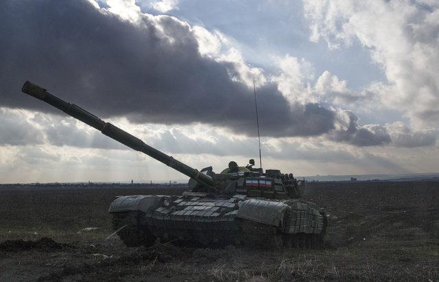 A tank of the separatist self-proclaimed Donetsk People's Republic is seen near Yenakiieve, Donetsk region, February 4, 2015. (Photo by Maxim Shemetov/Reuters)