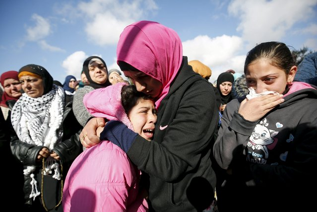 The daughter (L) of Palestinian woman Mahdia Hamad reacts during her funeral in Silwad near the West Bank city of Ramallah December 26, 2015. (Photo by Mohamad Torokman/Reuters)