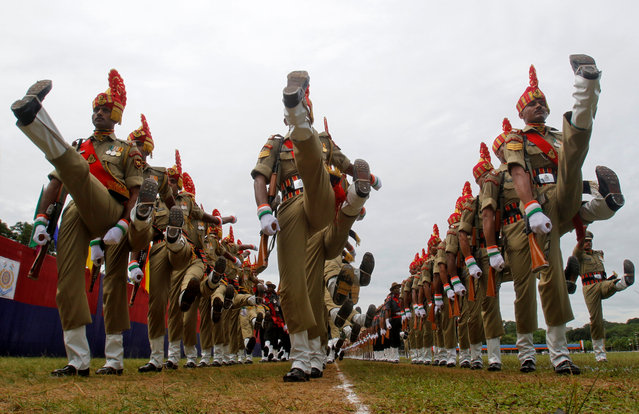 Border Security Force (BSF) soldiers march during a full dress rehearsal for India's Independence Day parade in Agartala, August 13, 2018. (Photo by Jayanta Dey/Reuters)