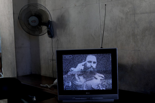 A television showing black and white footage of Fidel Castro delivering a speech sits on a table at a memorial in his honor in Guanabacoa on the outskirts in Havana, Cuba, Tuesday, November 29, 2016. (Photo by Natacha Pisarenko/AP Photo)
