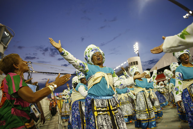 Dancers from the Nene de Vila Matilde samba school perform during a carnival parade in Sao Paulo, Brazil, Saturday, February 14, 2015. (Photo by Andre Penner/AP Photo)