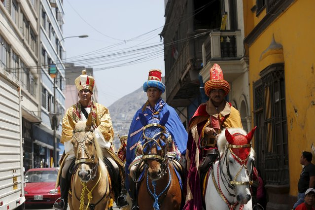Policemen dressed as the Three Wise Men - Melchior, Balthasar and Gaspar - ride horses during the celebration of Epiphany, or Three Kings' Day, in central Lima January 6, 2016. (Photo by Janine Costa/Reuters)