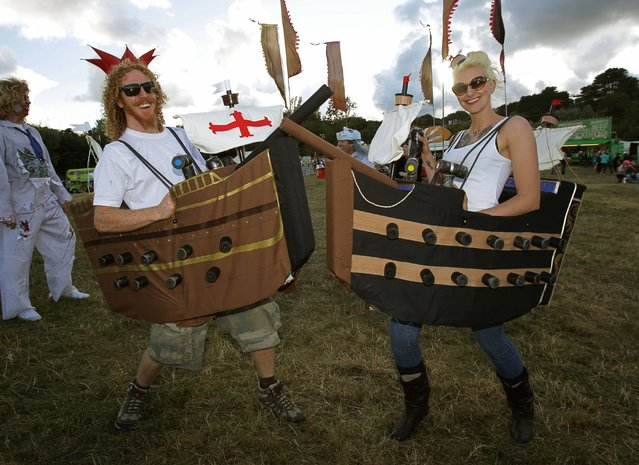 Festival goers in fancy dress at Bestival, held at Robin Hill Country Park on the Isle of Wight, on September 7, 2013. (Photo by Yui Mok/PA Wire)