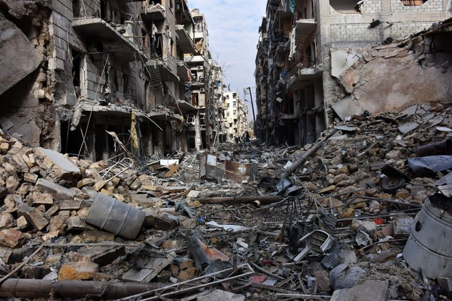 A general view shows destruction in the al- Shaar neighbourhood after government forces took control of the area in the eastern part of the northern city of Aleppo on December 7, 2016. (Photo by George Ourfalian/AFP Photo)