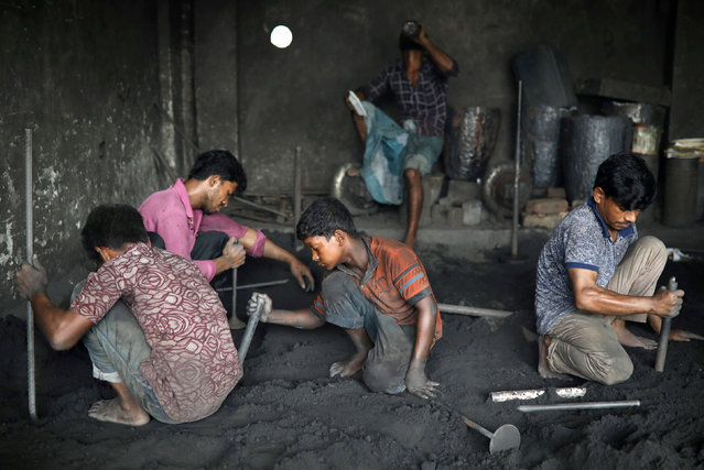 Workers including children work at a dockyard in Dhaka, Bangladesh, September 20, 2018. (Photo by Mohammad Ponir Hossain/Reuters)