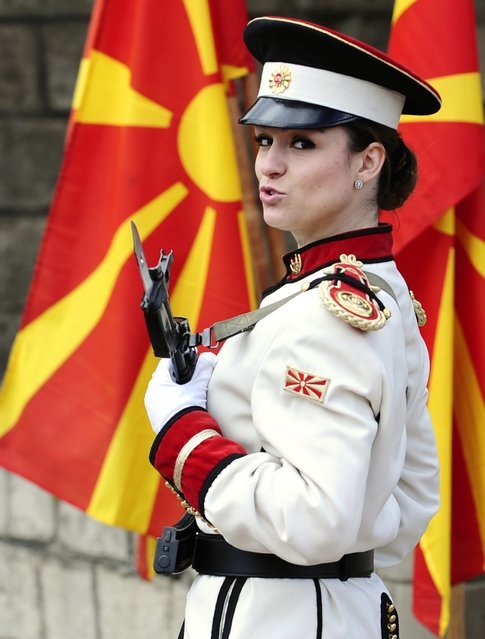 Corporal Dragana Kitanovska attends an honour guard training session at an army barracks in Skopje March 4, 2015. Macedonia's honour army battalion, the ceremonial uniformed guard that receives every foreign president, dignitaries and delegations, but also sees off and welcomes the head of state every time he leaves the country, has a different glow. For the first time in the history of Macedonia's army, the honour guard has two women in its ranks. There has not been an event in which one of them is not in the first row. Verica Zlatevska joined the army in 2003, Kitanovska in 2006. Picture taken March 4, 2015.   REUTERS/Ognen Teofilovski (MACEDONIA  - Tags: MILITARY SOCIETY)