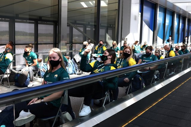 Australian softball national team players wait for the quantitative antigen test after arriving at the Narita Airport in Chiba prefecture on June 1, 2021 to take part in the upcoming Tokyo 2020 Olympic Games. (Photo by Behrouz Mehri/Pool via AFP Photo)