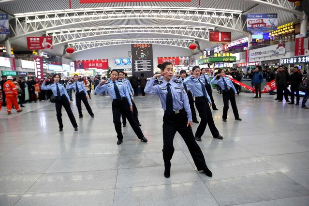 Policemen of the Shenyang Railway perform during a flash mob at the waiting hall of the station, January 24, 2016, in Shenyang, China. Policemen held activities to call for the safety during the Spring Festival travel rush at Shenyang Railway Station. (Photo by ChinaFotoPress/Getty Images)