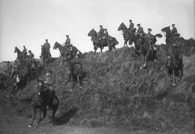 The Canadian cavalry undergo training at Shorncliffe during World War I, riding their horses down the steep slope of a hill. October 1915. (Photo by Topical Press Agency/Getty Images)
