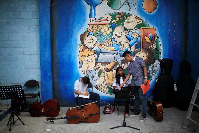 EL SALVADOR: Orchestra members from the Don Bosco Youth and Choir Orchestra participate in a practice in San Salvador, El Salvador April 20, 2016. (Photo by Jose Cabezas/Reuters)