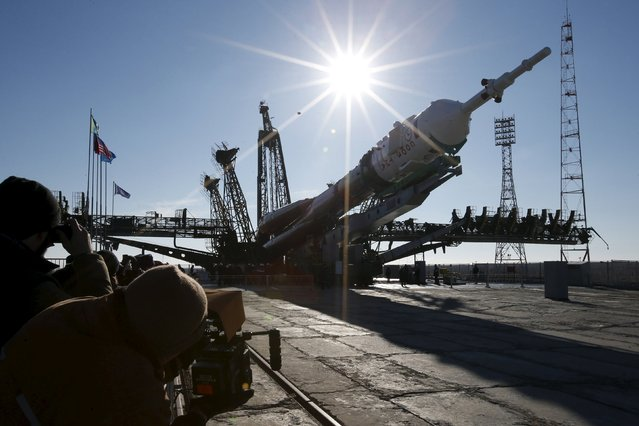 The Soyuz TMA-16M spacecraft is lifted to its launch pad at the Baikonur cosmodrome March 25, 2015. (Photo by Maxim Zmeyev/Reuters)