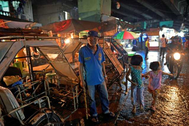 """Marianito Navarra, 54, village watchman patrols a street in Pasay city, Metro Manila, Philippines November 2, 2016. """"I pity the families of those who are killed, especially those who really had nothing to do with crime. There have been a lot of people who were killed that weren't really involved with drugs. They should just arrest them"""", he said. (Photo by Ezra Acayan/Reuters)"""