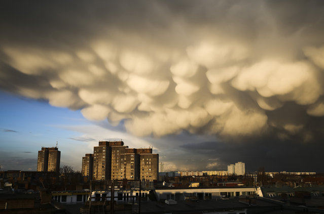 Clouds cover the sky over the Ernst-Taehlmann-Park housing estate after a thunderstorm in Berlin, Germany, Thursday, March 11, 2021. (Photo by Markus Schreiber/AP Photo)