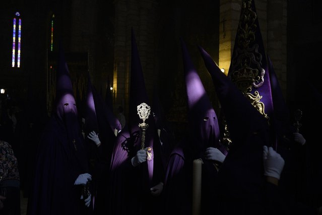 "Hooded penitents  from ""El Calvario"" brotherhood take part during a Holy Week procession in Cordoba, Spain, Wednesday, April 1, 2015. (Photo by Manu Fernandez/AP Photo)"
