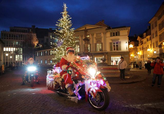 Harley Davidson bikers dressed as Santa Claus are seen in Zurich, Switzerland on December 1, 2018. (Photo by Arnd Wiegmann/Reuters)