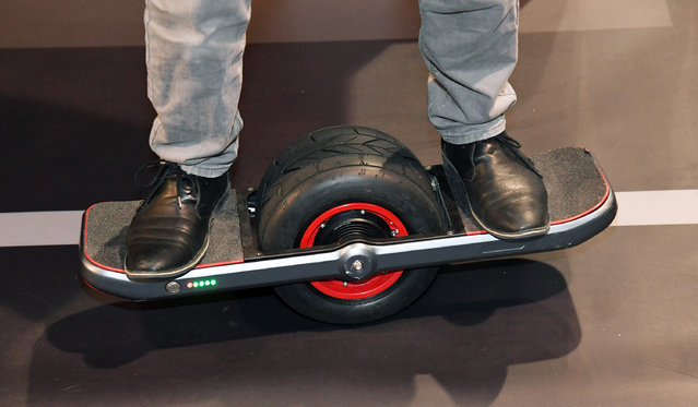 Brandon Yamawaki demonstrates the Jyro Roll at CES 2017 at the Sands Expo and Convention Center on January 5, 2017 in Las Vegas, Nevada. The USD 1,299, self-balancing, single-wheel skateboard will be available in the Fall of 2017. (Photo by Ethan Miller/Getty Images)