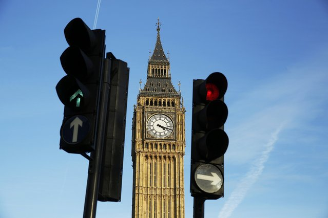 Red and green traffic lights direct traffic in front of the Big Ben bell tower at the Houses of Parliament  in London, Britain February 22, 2016. Prime Minister David Cameron will try to sell his case for Britain remaining in the European Union to parliament on Monday, facing hostility from his own lawmakers and an exit campaign energised by the backing of London Mayor Boris Johnson. (Photo by Luke Macgregor/Reuters)