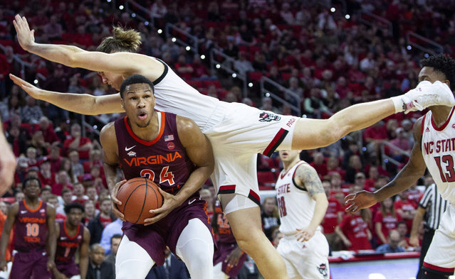 Virginia Tech's Kerry Blackshear Jr. (24) is fouled by North Carolina State's Wyatt Walker, right, during the second half of an NCAA college basketball game in Raleigh, N.C., Saturday, February 2, 2019. (Photo by Ben McKeown/AP Photo)