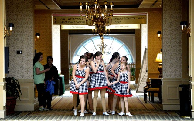 Dancers from the Rhythm and Class Dance Company wait outside a Marriott Hotel ballroom before they perform during the United Way of the CSRA 2016 Annual Meeting in Augusta, Ga., Tuesday, February 23, 2016. (Photo by Michael Holahan/The Augusta Chronicle via AP Photo)