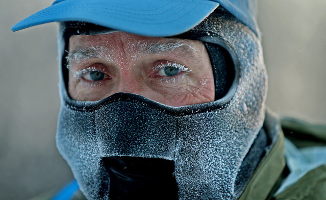 John Brower snow in his eye lashes after running to work in the frigid -20 weather Monday, Jan. 6, 2014 in Minneapolis. (Photo by Elizabeth Flores/AP Photo/The Star Tribune)