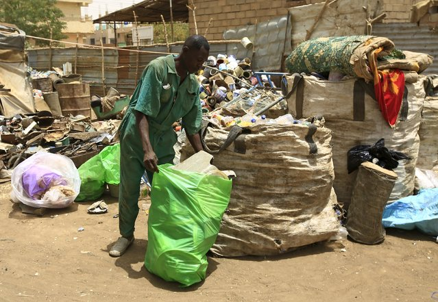 A man waits near different types of plastic materials after bringing them to a recycling station in Khartoum North April 16, 2015. (Photo by Mohamed Nureldin Abdallah/Reuters)