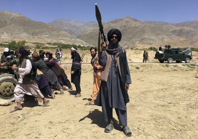 Taliban soldiers stand guard in Panjshir province northeastern of Afghanistan, Wednesday, September 8, 2021. (Photo by Mohammad Asif Khan/AP Photo)