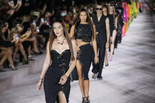 Gigi Hadid, from centre left, and Irina Shayk, lead models as they wear creations for the Versace Spring Summer 2022 collection during Milan Fashion Week, in Milan, Italy, Friday, September 24, 2021. (Photo by Luca Bruno/AP Photo)