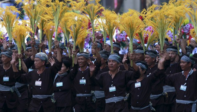 Vietnamese farmers march during a rehearsal for a military parade as part of the 40th anniversary of the fall of Saigon in southern Ho Chi Minh City (formerly Saigon City), Vietnam, on April 26, 2015. (Photo by Reuters/Kham)