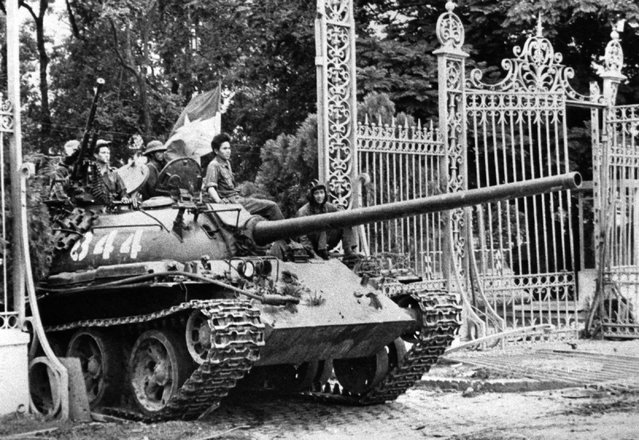 In this April 30, 1975 file photo, a North Vietnamese tank rolls through the gates of the Presidential Palace in Saigon, signifying the fall of South Vietnam. The war ended on April 30, 1975, with the fall of Saigon, now known as Ho Chi Minh City, to communist troops from the north. (Photo by AP Photo)