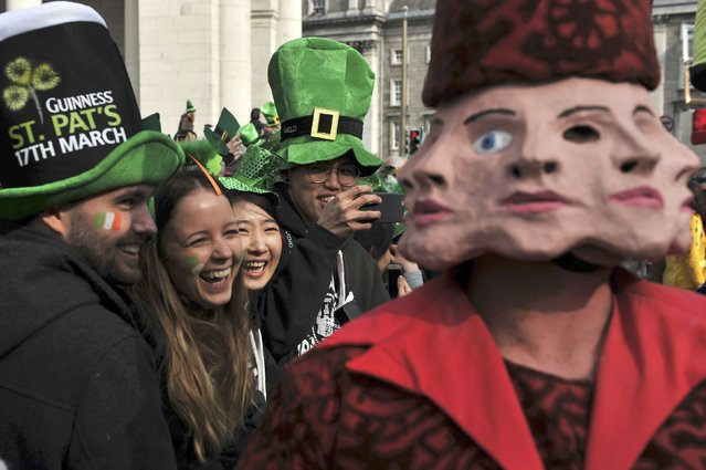 People enjoy the St. Patrick's day parade in Dublin, Ireland March 17, 2016. (Photo by Clodagh Kilcoyne/Reuters)