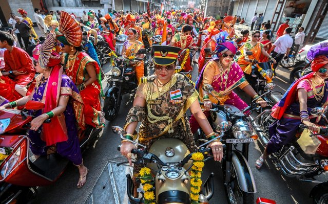 Indian people in traditional clothes take part in the procession to celebrate the Gudi Padwa, Maharashtrian's New Year in Mumbai, India, 06 April 2019. Gudi Padwa is the Hindu festival that falls on the first day of Chaitra month and marks the beginning of the Lunar Calendar, which dictates the dates for all Hindu festivals, also known as Panchang. (Photo by Divyakant Solanki/EPA/EFE/Rex Features/Shutterstock)